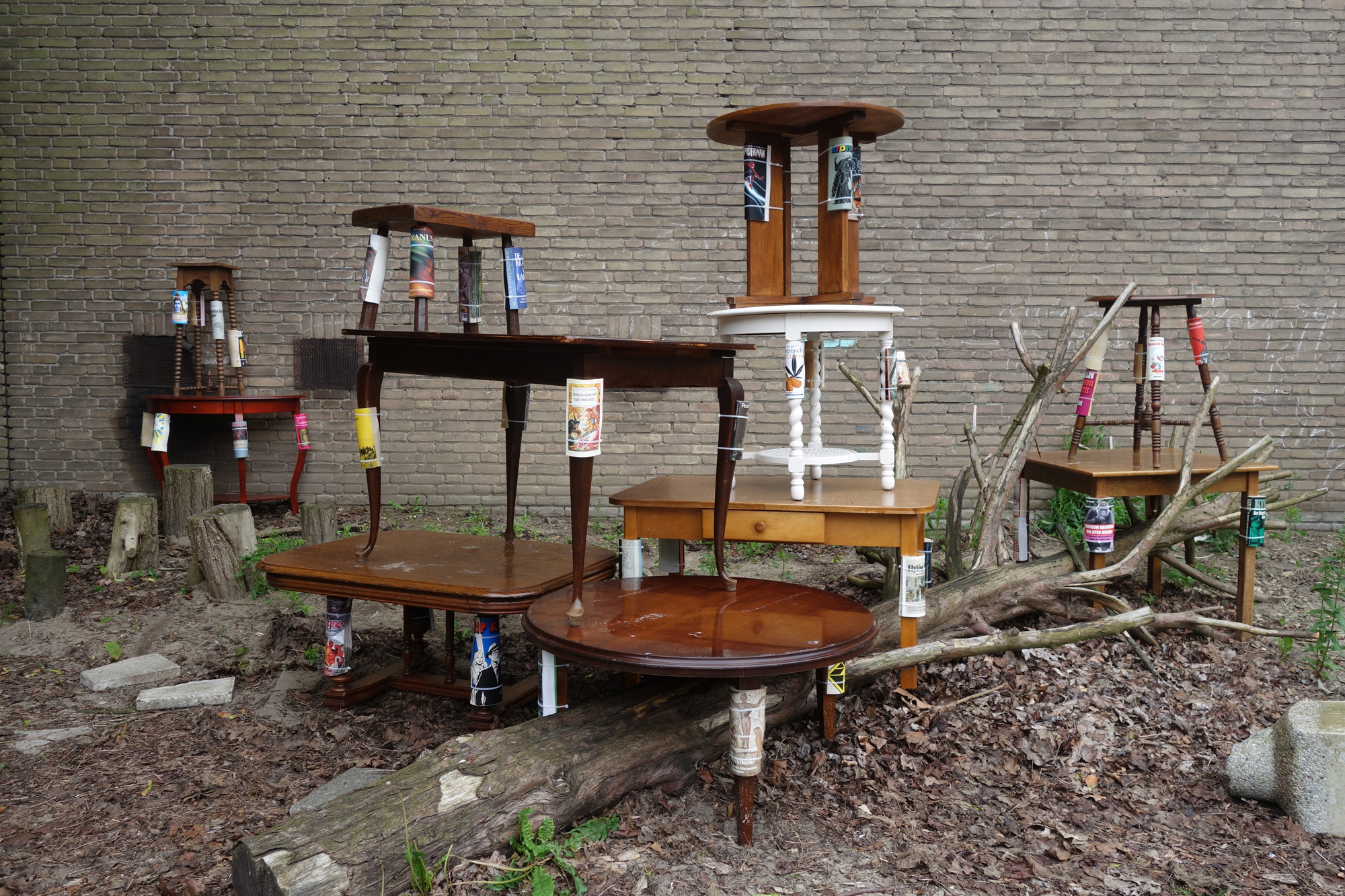 Mark-Salvatus-Claws-2016-Wooden-tables-books-catnip-Dimensions-variable